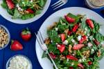 Strawberry spinach salad with poppyseed dressing, feta cheese, and walnuts.
