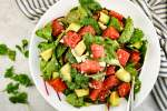 Watermelon avocado salad with cilantro and onions in a honey lime dressing.