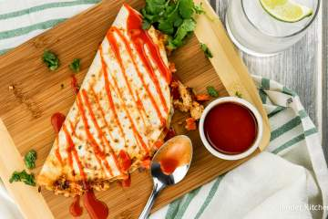 Healthy Buffalo Chicken Quesadillas packed with lean ground chicken, carrots, celery, cheese, and buffalo sauce is a deliciously simple recipe for only 316 calories.
