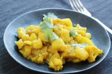 Cauliflower Potato Curry also known as Aloo Gobi is a powerhouse of flavor and made with ingredients and spices you probably have at home. It's healthy, hearty, and a dish you will make again and again.
