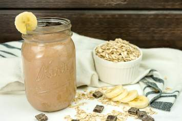 This healthy Chocolate Banana Smoothie lets you start the day with a chocolate shake! This hearty smoothie will keep you full all morning, has no added sugar, and packs in 10 grams of protein.