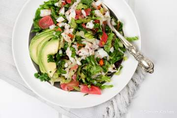 This Chopped Shrimp Salad with Lemon Vinaigrette makes a tasty light and healthy meal full of poached shrimp, veggies, herbs, and avocado.