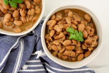 Crock Pot Pinto Beans come out super tender and creamy without any soaking! These slow cooker pinto beans have tons of flavors and are the perfect way to make homemade beans without spending hours soaking and simmering beans on the stove.