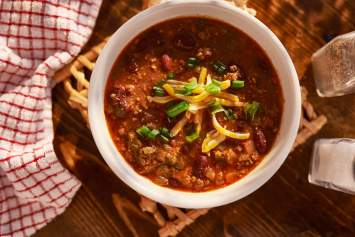 This Easy Beef Chili Recipe made with ingredients found in your pantry and ready in just 30 minutes. This simple chili is packed with flavor, good for you, and you won't believe it hasn't been simmering on the stove all day.