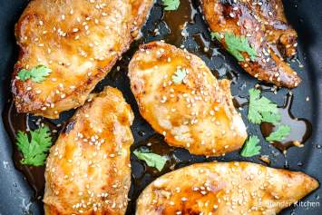 Honey Soy Glazed Chicken is marinated in soy sauce, honey, garlic, sesame oil, and green onions and can be cooked in a skillet, on the grill, or quickly broiled for an easy and healthy dinner.