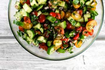 Israeli Chopped Salad packed with tomatoes, cucumbers, fresh herbs, and a delicious lemon dressing for a healthy, refreshing side dish.