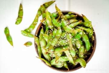 Sesame Soy Edamame cooked with sesame oil, soy sauce, and a touch of red pepper flakes take edamame to a whole new level. This savory dish has tons of flavor and you'll never want to go back to eating plain edamame again.