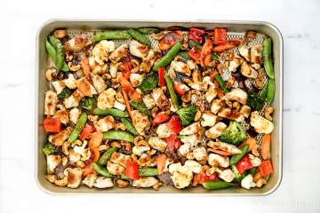 Thai Cashew Chicken and Vegetables made all on one sheet pan for a healthy, easy dinner that tastes just like your favorite takeout. This dish is the perfect balance of sweet and spicy, full of protein from the chicken and cashews, and packed with veggies.
