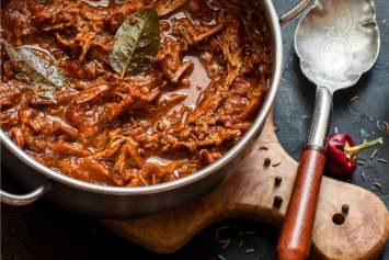 Slow Cooker Beef Ragu packed with tender shredded beef and tomatoes for perfect sauce that tastes like you stood at the stove for hours.