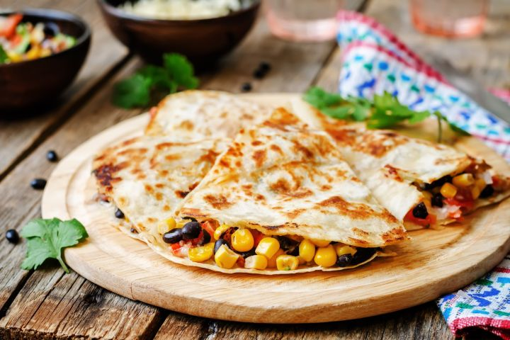 These Black Bean and Corn Quesadillas are seriously delicious and a meal you can feel good about feeding your family. Packed with black beans, corn, tomatoes, cheese, and taco seasoning, these quesadillas have so much flavor. Plus you can freeze them!