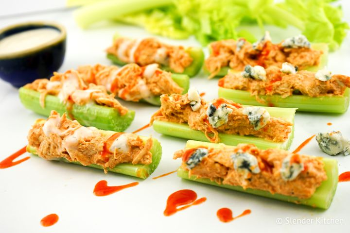 Buffalo Chicken Celery Bites stuffed with a light buffalo chicken salad with topped with ranch or blue cheese make the perfect healthy appetizer or snack with under 100 calories for four bites.