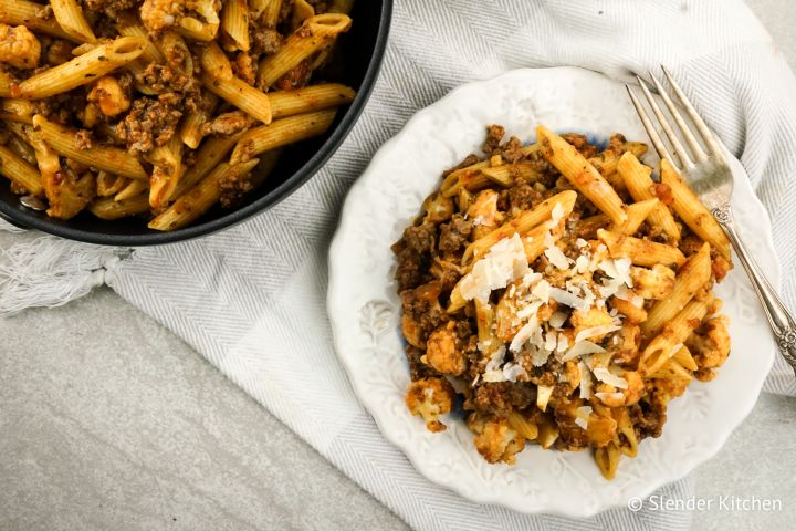 Garlic Cauliflower and Sausage Pasta is easy to make and packs in so much flavor with lean turkey sausage, tender cauliflower, and a quick tomato sauce.