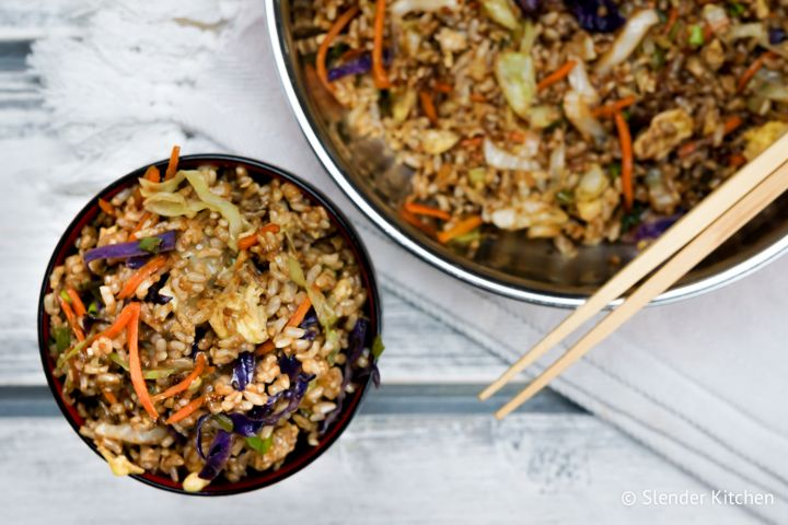 Healthy Fried Rice made with cooked brown rice, eggs, and cabbage tastes just like the real thing but only has 130 calories per serving.