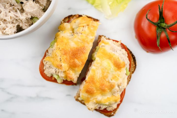 Healthy tuna melt served open faced with tomato slices and cheddar cheese.