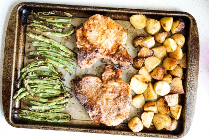 Sheet Pan Pork Chops, Potatoes, and Green Beans is a healthy dinner with savory pork chops, potatoes, and green beans cooked on just one pan.