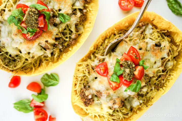 Pesto Spaghetti Squash with Turkey Sausage is a low carb dish that's filling and packed with flavor from a homemade basil pesto and lean turkey sausage. Topped with melted cheese, this dish is one you will make again and again.