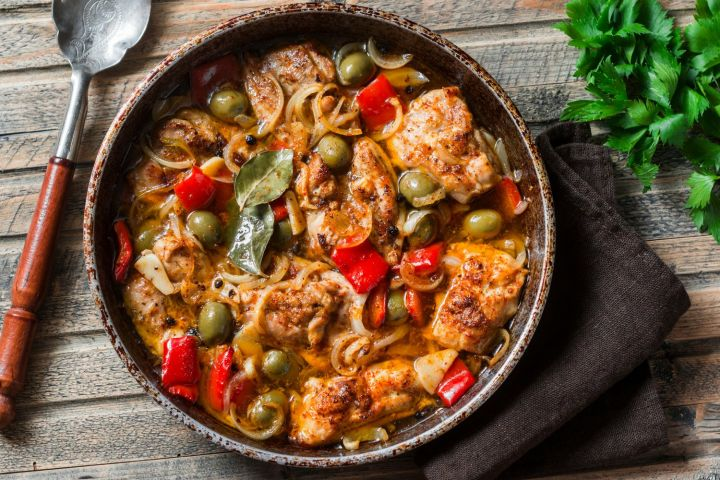Slow Cooker Mediterranean Chicken with tender chicken thighs, olives, sweet red peppers, and onion couldn't be more delicious and is healthy too.