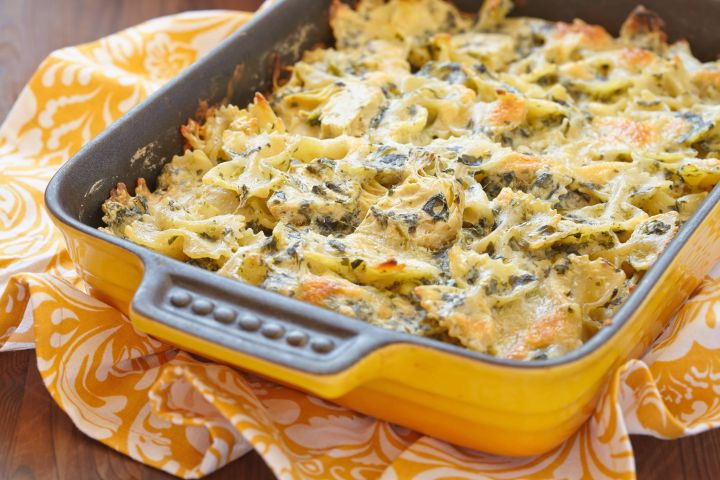 Spinach Artichoke Pasta that is surprisingly good for you with tons of veggies for under 350 calories. Made with a quick homemade sauce using spinach, artichoke hearts, and light cream cheese, this dish has so much flavor and is ready in just 30 minutes.