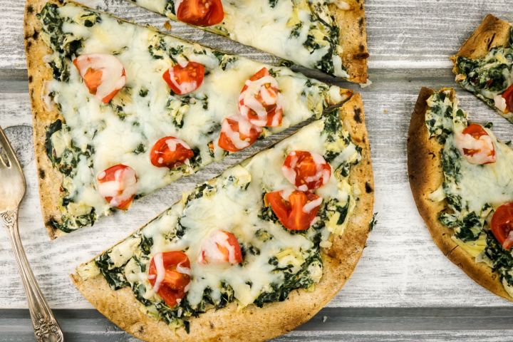Spinach Artichoke Pizza takes all the flavors of your favorite dip in a healthy pizza that's ready in under 10 minutes!
