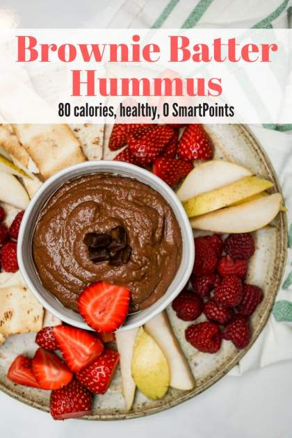 Brownie Batter Chocolate Hummus is the perfect sweet, healthy snack and you won't believe how delicious it tastes with fruit, pretzels, and more.