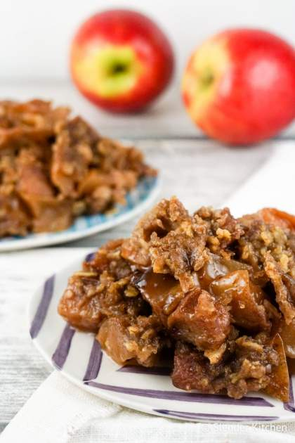 Healthy Slow Cooker Apple Crisp couldn't be easier to make and is filled with tender apples, cinnamon, and a crispy crumble topping that you will love.