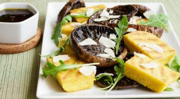 Grilled Balsamic Mushrooms with Polenta with garlic, thyme, balsamic vinegar, and Parmesan cheese all cooked on the grill in 10 minutes.