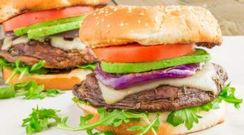Portobello Burgers with Swiss Cheese and Avocado made on the grill for the perfect vegetarian burger that's healthy and ready in no time.